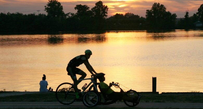 This image has an empty alt attribute; its file name is st-louis-trails-cyclists.jpeg